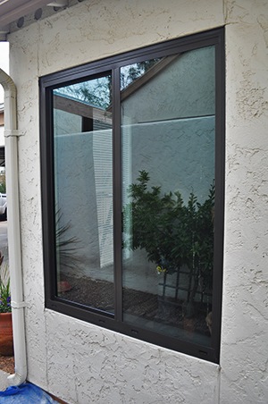 finished product an aluminum hop window installed cleaned and ready to enjoy