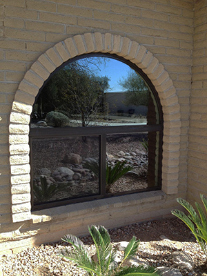 an example of a field-installed arched picture window with horizontal-slider aluminum-framed replacement window by American Openings