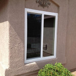 example of a horizontal sliding vinyl replacement window on a frame-stucco home
