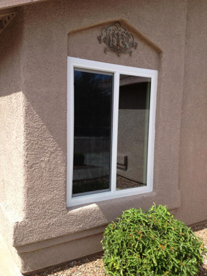 example of a horizontal sliding vinyl window on a frame-stucco home